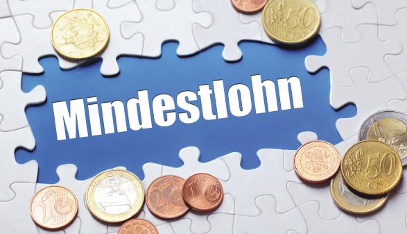 Schriftzug Mindestlohn mit Münzen © Coloures-pic/stock.adobe.com